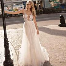 Backless Appliqued with Lace Deep V Neck Beach Wedding Gown Spaghetti Strap image 1