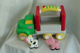 LITTLE TIKES HAND HELD FARM TRUCK  WITH SOUNDS,MUSIC, COW AND A PIG - $17.25