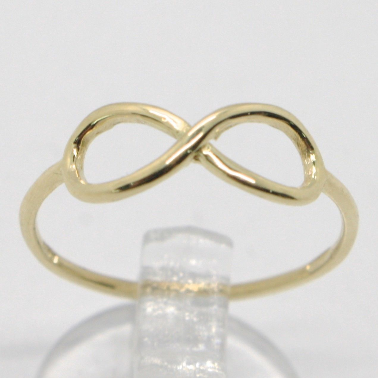 18K YELLOW GOLD INFINITE CENTRAL RING, INFINITY, SMOOTH, BRIGHT, MADE IN ITALY
