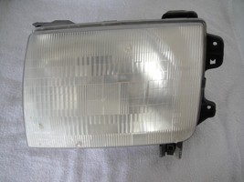 NISSAN FRONTIER 1998-2000 LEFT/DRIVERS SIDE HEADLIGHT USED - $21.76
