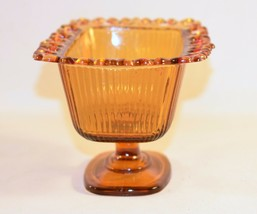 Vintage F.T.D.A. 1981 Amber Glass Ribbed Pedestal Candy Dish - $9.87