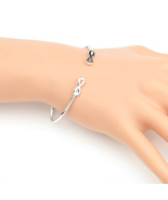 UE- Stylish Silver Tone Designer Bangle Bracelet With Trendy Infinity De... - $12.99