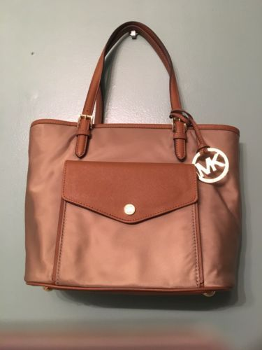 fd34b42a6678 12. 12. Previous. Authentic Michael Kors Jet Set Item Nylon Pocket Tote  Dusk MSRP $198 NWT. Authentic Michael Kors ...