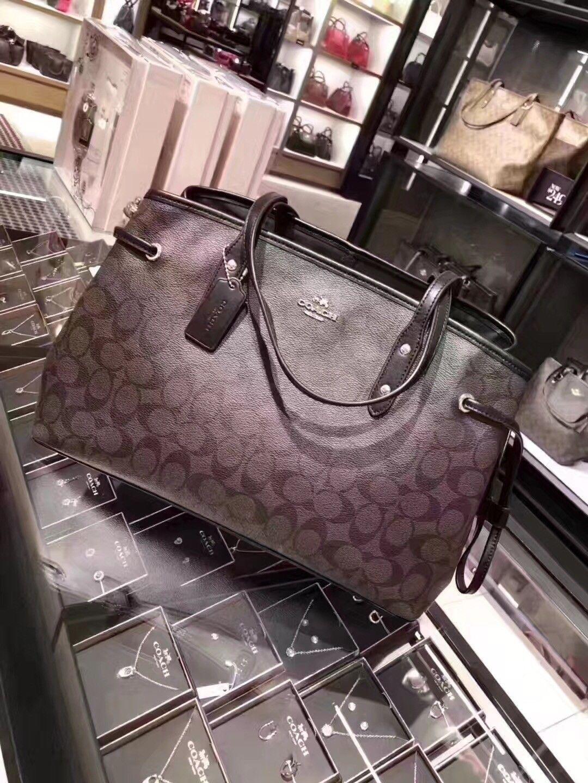 57. 57. Previous. New COACH F57842 Drawstring Carryall in Brown Black  Signature Shoulder Handbag 653b9dca4020e