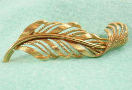 Vintage Monet Brushed Gold Plate Curled Feather Brooch Pin Openwork Grac... - $15.79