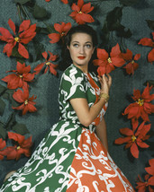 Dorothy Lamour colorful dress with bright red flowers behind 16x20 Canvas - $69.99