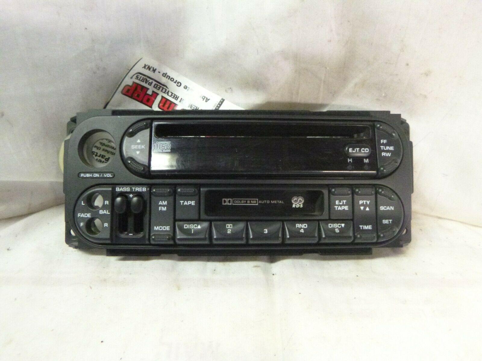 02-07 Dodge Chrysler Jeep Radio CD Cassette Face Plate P05064300AC PRM17