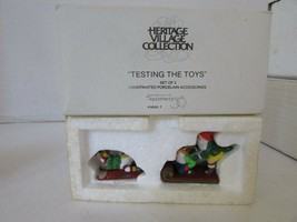 DEPT 56 56057 TESTING THE TOYS SET OF 2 FIGURES HERITAGE VILLAGE NICE L146 - $14.65