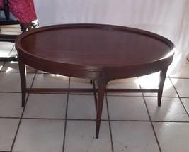 Mid Century Hepplewhite Oval Mahogany Coffee Table by Carolina - $399.00