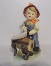 """Vintage Hummel-Like 7"""" Figurine Boy in Overalls Sawing Wood Log - $7.92"""
