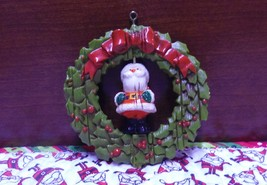 1976 Vintage Hallmark Santa In A Wreath Twirl About Ornament - $8.99