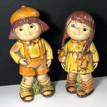 1977 PORCELAIN FIGURINES school boy girl bobby orange yellow sculpture g... - $34.65