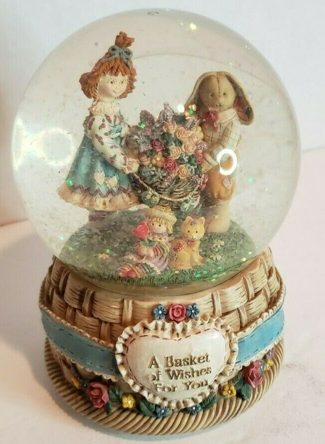 "Primary image for San Francisco Music Box Company Snow Globe ""A Basket of Wishes For You"" bunny"