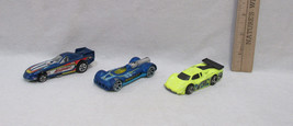 Hot Wheels Diecast Cars By Mattel Race Cars 2 Blue & 1 Yellow Lot Of 3 - $8.90