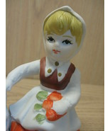 Ceramic Statue Figurine Little Girl Holding Carrots and Patting Bunny's Ear - $7.95