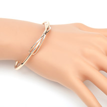 UE- Trendy Rose Tone Designer Bangle Bracelet With Contemporary Infinity... - $13.99