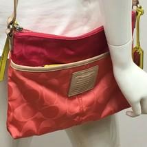 Coach 24861 Legacy Weekend Signature Nylon Hippie File Crossbody Bag Pink - $64.99