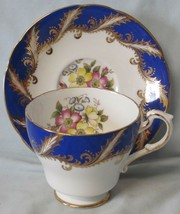 Paragon Cup & Saucer Floral Pattern white with Cobalt & Gold Trim Outside Cup - $39.49