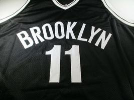 KYRIE IRVING / AUTOGRAPHED BROOKLYN NETS BLACK CUSTOM BASKETBALL JERSEY / COA image 2