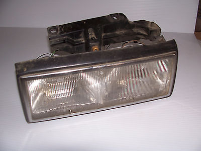 Primary image for 1993 1992 1991 LEFT HEADLIGHT DEVILLE FWD FLEETWOOD OEM USED ORIG CADILLAC