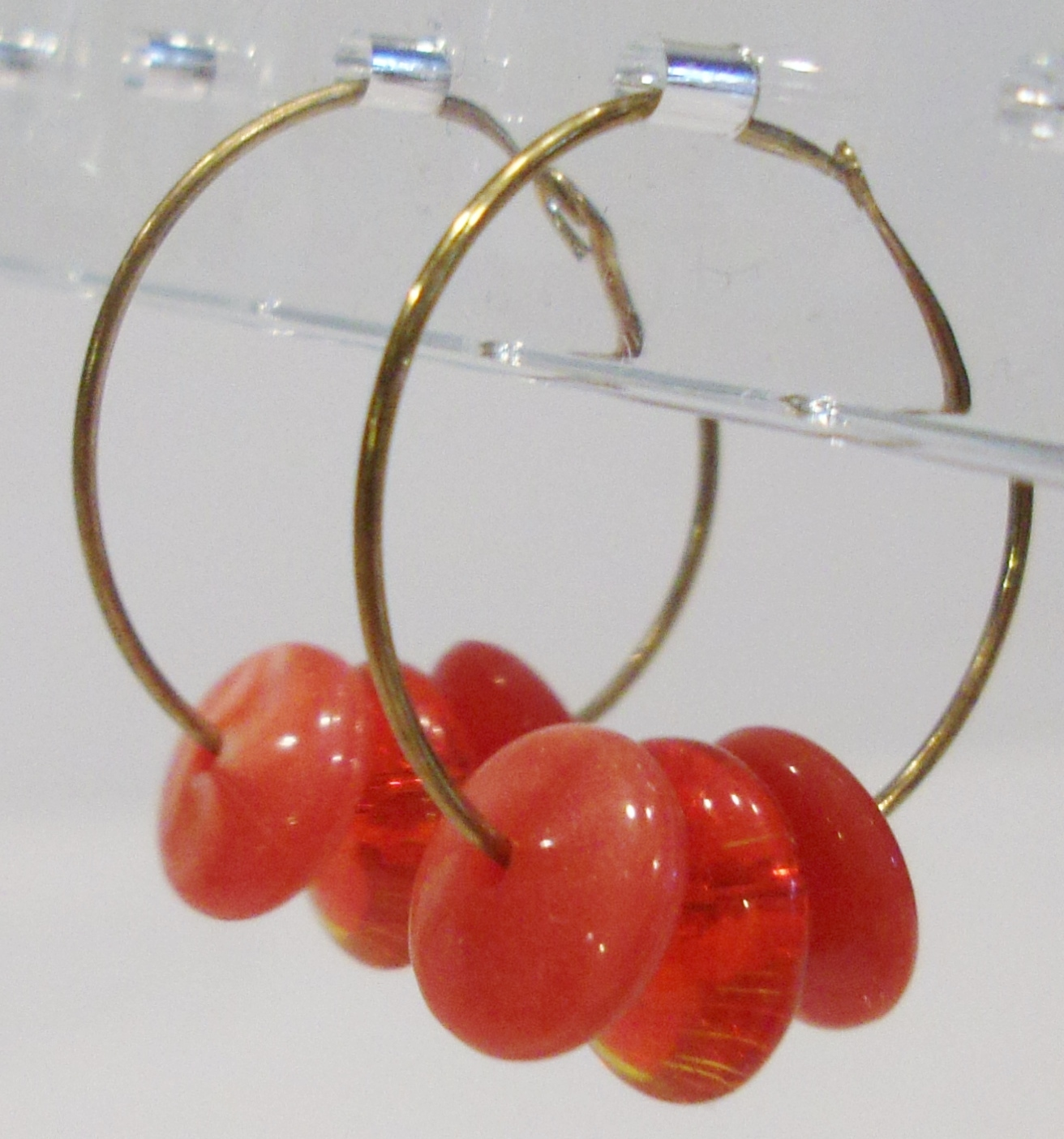 handmade gold hoop earrings with red disc beads