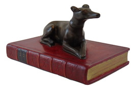 Mid Century bookend Greyhound Dog resting on a red book - $99.99