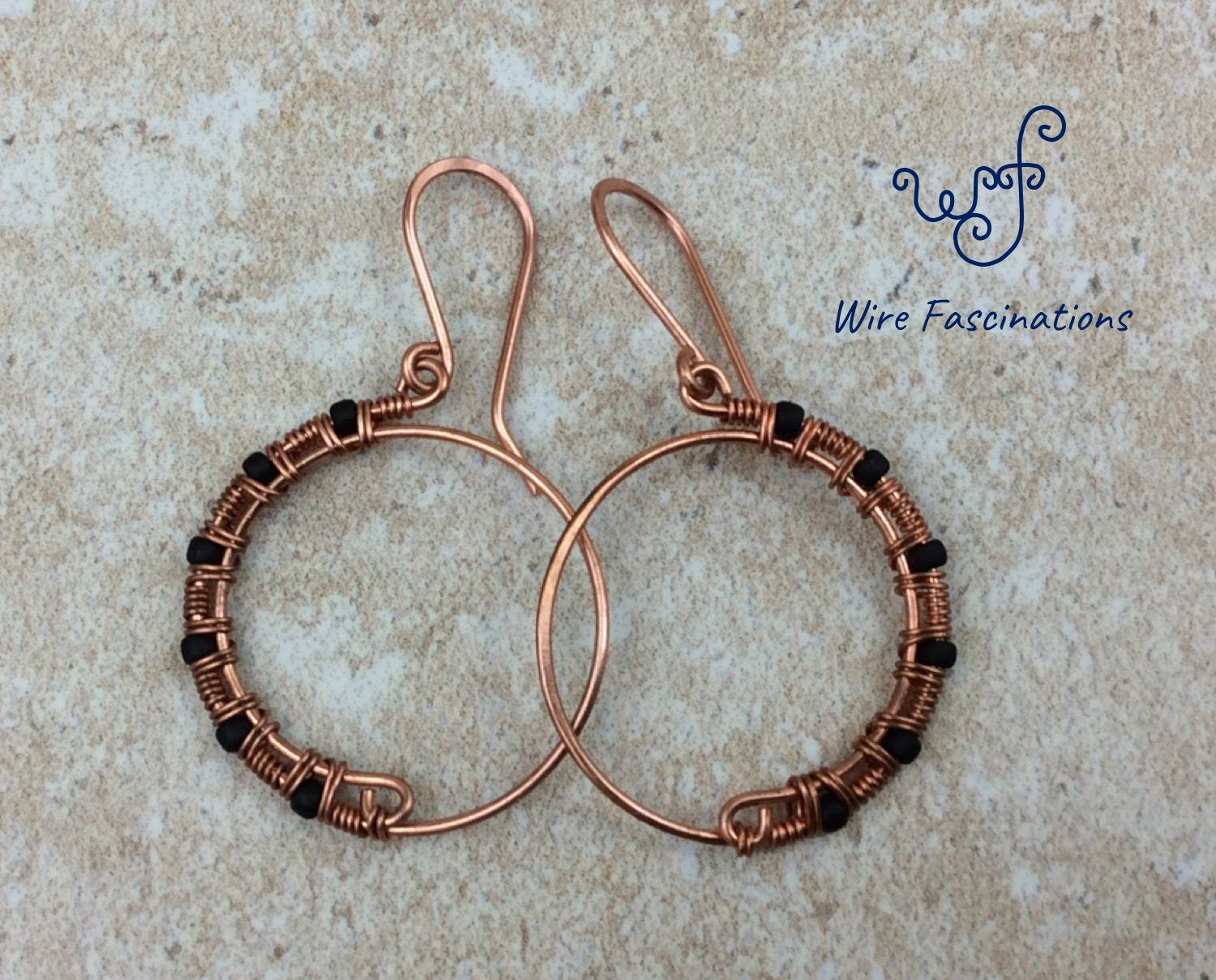 Handmade copper earrings hoops wire wrapped black beads main