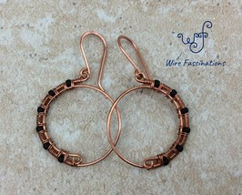 Handmade copper earrings: hoops half wire wrapped with matte black glass... - $27.00