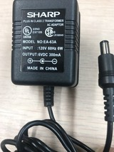 Sharp EA-63A AC Power Supply Adapter Charger Output: 6V DC 300mA          O8