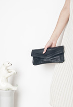 70s vintage leather clutch - $40.80