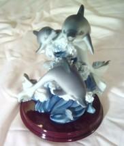 Trio 3 dolphins ceramic figurine on wood base - $33.65