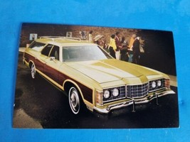 VTG UNUSED POSTCARD.1973 FORD LTD COUNTRY SQUIRE STATION WAGON. - $9.49