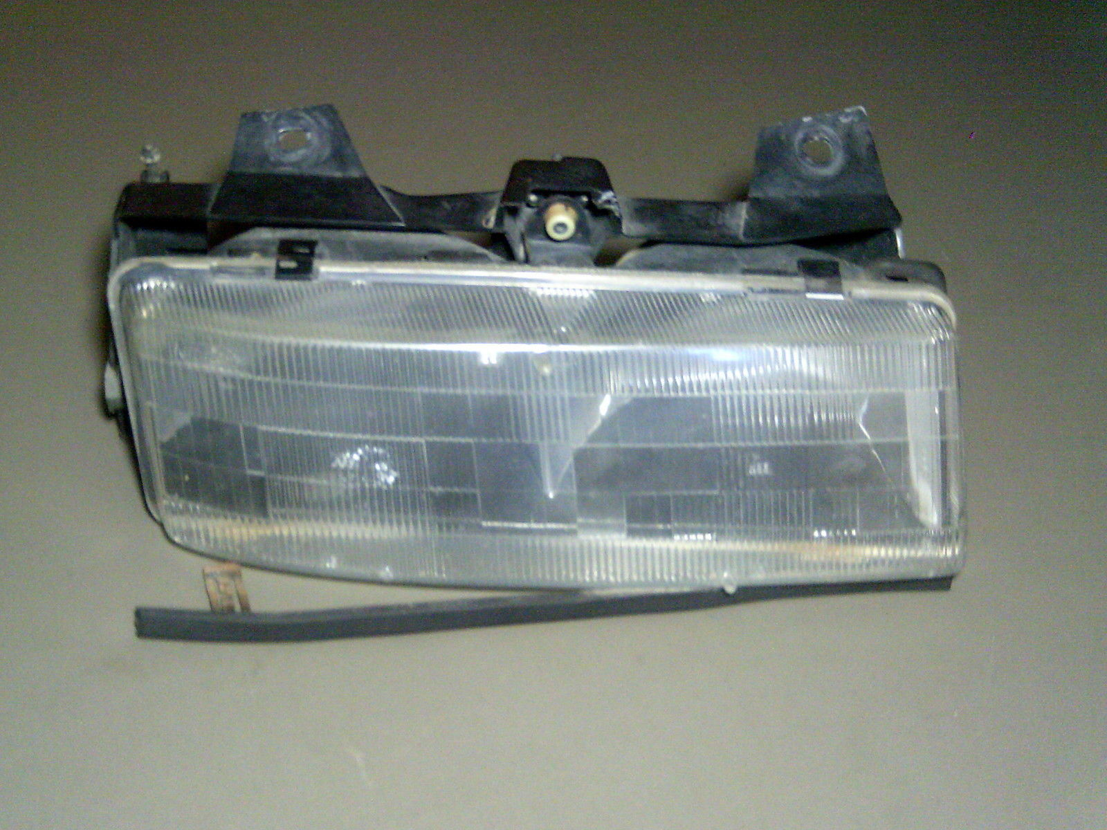 Primary image for 90-96 Corsica 90 91 92 93 Tempest RH Headlight Light Housing With Bracket