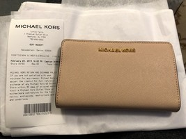 211d8f581bee Nwt Michael Kors Mk Logo Pvc Jet Set Travel Slim Bifold Wallet Ballet -  $49.25