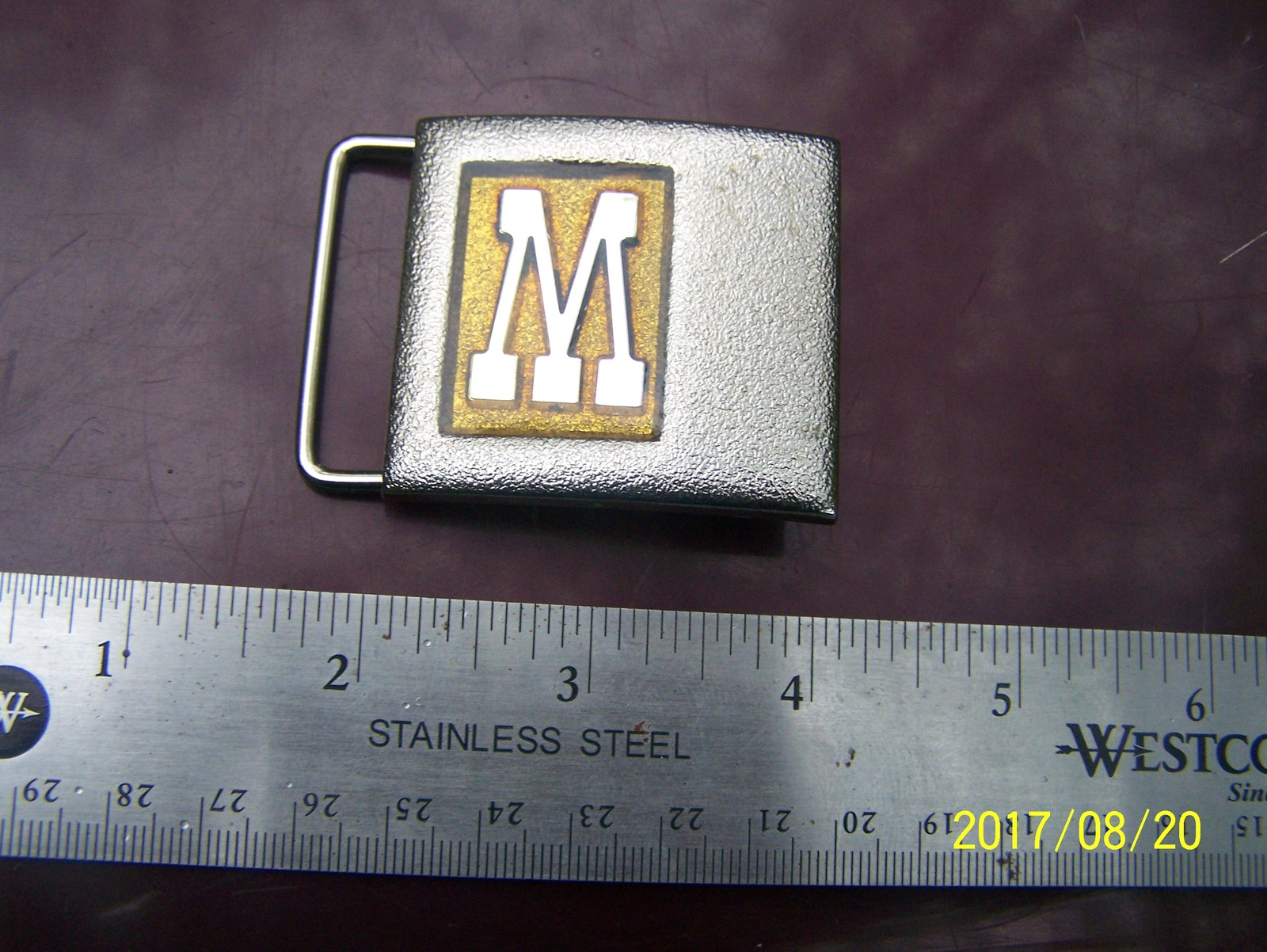 M or W Lee beltbuckle