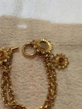 Vyg Gold tone costume bracelet with starburst charms - $3.98