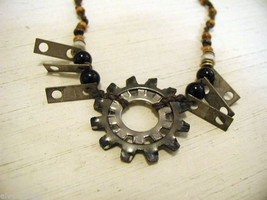 Re purposed tribal punk hand knotted necklace with metal garage artifacts gears