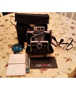 VINTAGE POLAROID AUTOMATIC 250 LAND CAMERA WITH CASE AND ACCESSORIES - $800.00