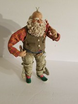 "10"" FIGURE OF COWBOY SANTA ANSWERING THE CANDY CANE. - $46.74"