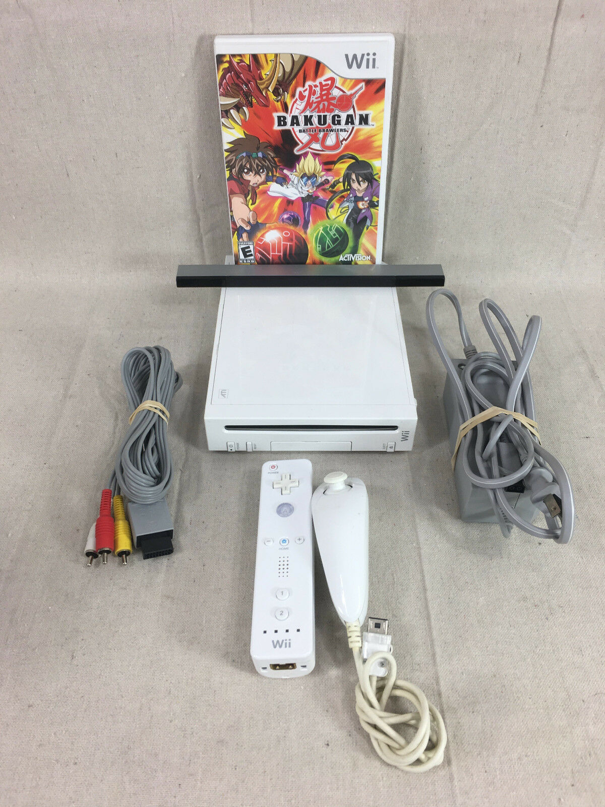 Wii, Includes 1 Controller 1 Nunchuk, Sensor Bar and Bakugan Battle Brawlers