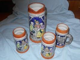 """4 Piece Set: 9"""" Tall Tankard Pitcher Stein & (3) 12 oz. Mugs German Moti... - $50.00"""