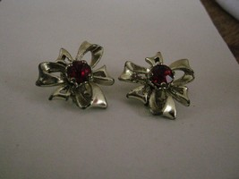 EARRINGS red RHINESTONES in the middle of SILVER colored metal BOWS CLIP - $2.96