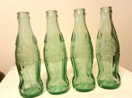 Coca Cola Hobbleskirt Bottles Small 6 Ounce Set of 4 Different Locations - $14.85