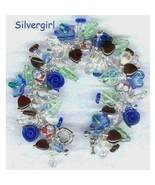 Floral Encased Lampwork Sparkly Czech Heart Full Charm Bracelet - $49.99