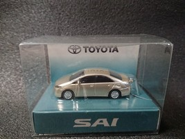 TOYOTA SAI LED Light Keychain Beige metallic Pull Back Not Sold in stores - $24.02