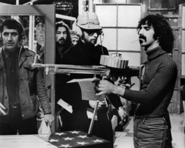 Frank Zappa in 200 Motels cigarette in mouth looking at machine gun 8x10 Photo - $7.99
