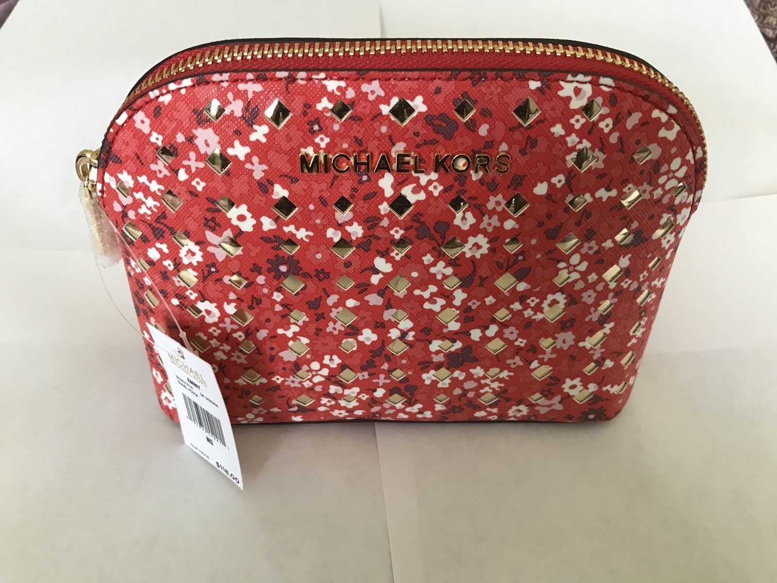 a89e2bcc4069 S l1600. S l1600. Previous. Michael Kors Emmy Dark Sangria Floral PVC  Leather Travel Pouch Cosmetic Case