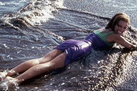 Raquel Welch sexy leggy lying on beach in ocean 18x24 Poster - $23.99