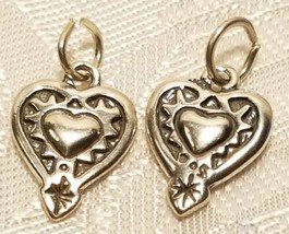 RAISED EMBOSSED HEART STERLING SILVER CHARM