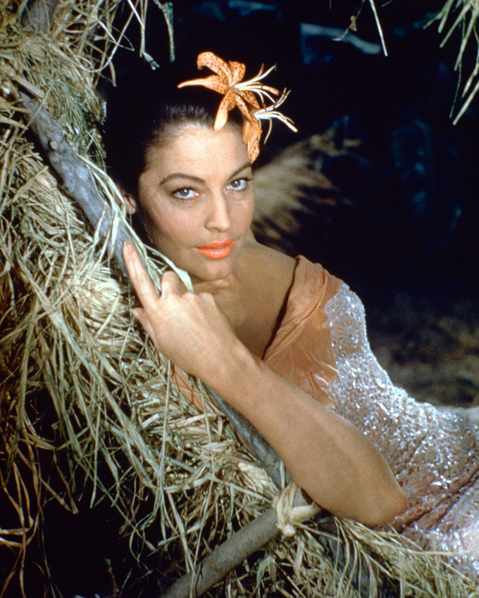 Primary image for Ava Gardner 16x20 Canvas Giclee Flower in Hair Lying on Straw Bed